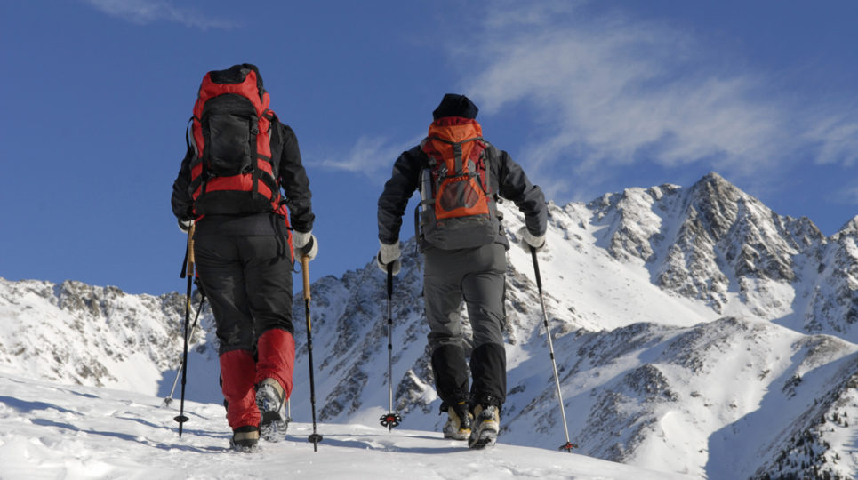 Two-People-Cross-Country-Skiing-on-a-Mountain